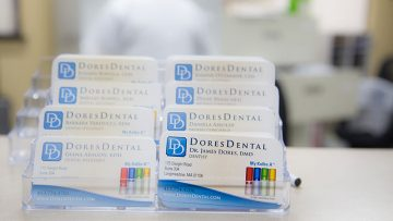 Take one of our Business Cards at Dores Dental in East Longmeadow, MA